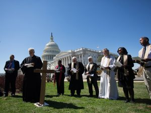 Christian leaders protest the federal budget cuts President Trump has proposed during a demonstration outside the U.S. Capitol on March 29, 2017.  Photo courtesy of Joseph Molieri/Bread for the World